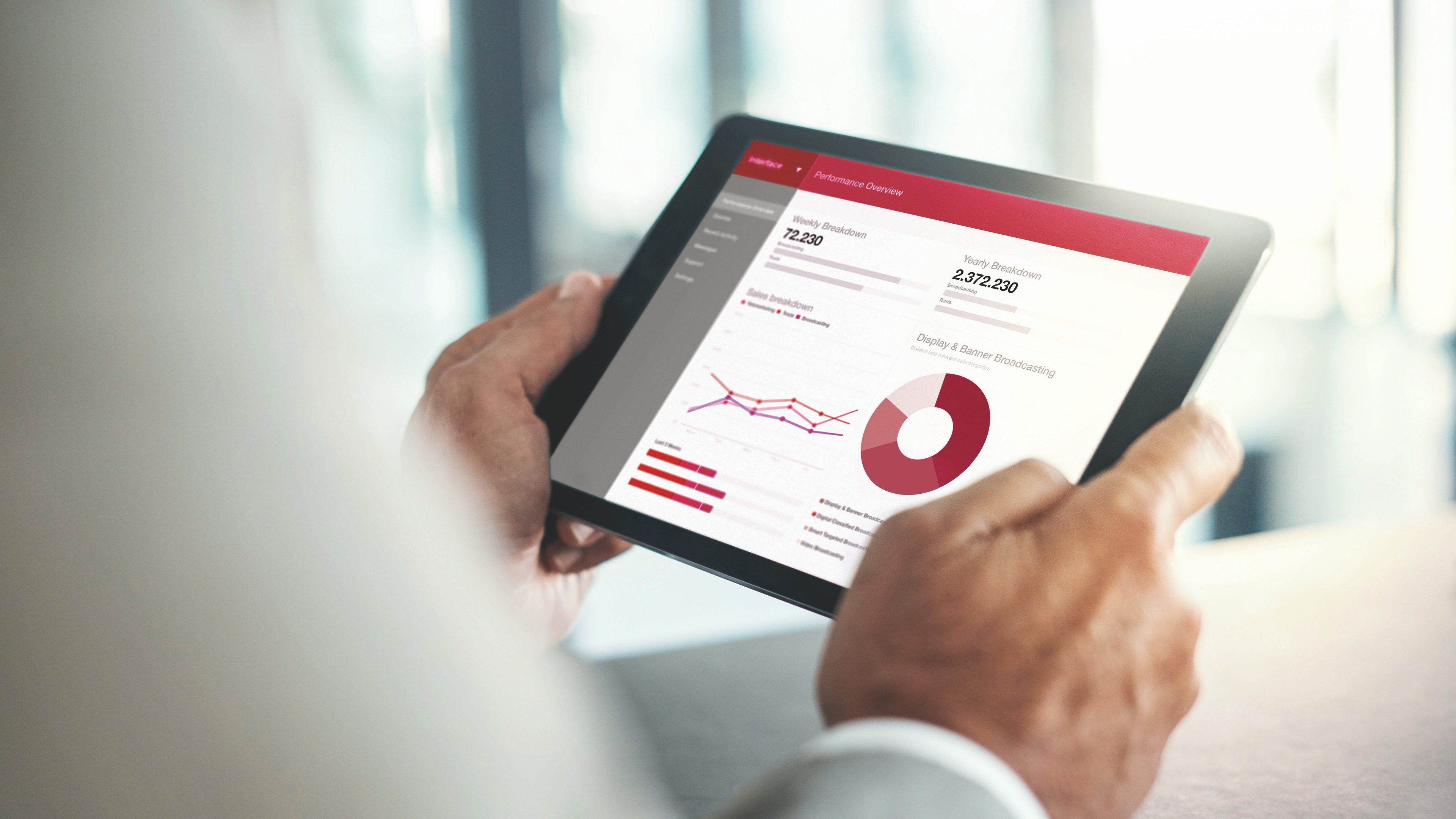 Cropped shot of a businessman using a digital tablet with graphs on the screen